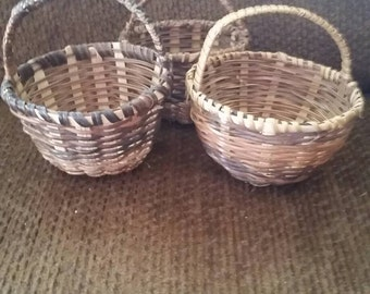 3  brown variegated baskets with handles