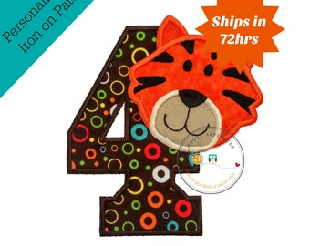 Tiger, birthday number 4 iron on applique in bright orange black detailed embroidered face on circle print fabric brown background, trim