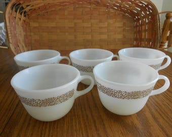 Vintage collection of  Pyrex milk glass  cups Woodland pattern