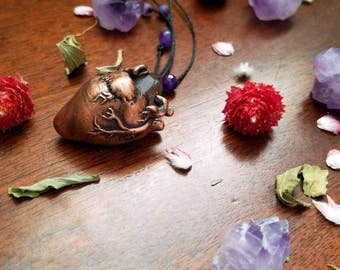 Amethyst crystal growing out of an electroformed anatomical heart