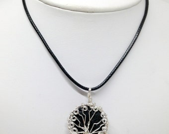 Silver tree of life pendant with black lava bead and black leather cord