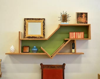 Wall mounted shelf from reclaimed wood with green interior