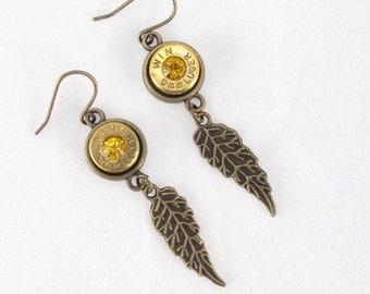 Earring-Winchester 9mm bullet casing-gold Swarovski crystal-brass feather dangles-brass bezel-brass earring findings-ammo jewelry-cowgirl