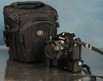 Nikon EM 35mm SLR w/ Vivitar 28mm lens, motor drive and bag