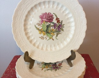 This is a listing for 6 Spode Luncheon Plates in the Heath and Rose Pattern