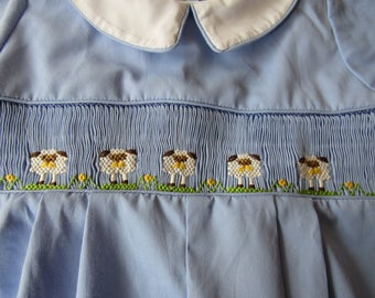 Hand smocked Easter romper with sheep.