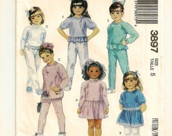 A Pullover Long & Short Sleeve Dress and Top with Neckline / Ruffle Variations, and Pull-On Pants Pattern: Childrens Size 5 • McCall's 3897