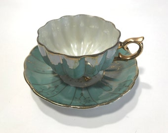 Vintage Porcelain Mother Of Pearl Tri Footed Tea Cup and Saucer Green with Gold Trim