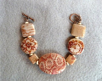 Red Fossil Coral and Floral Decoupage Beaded Bracelet