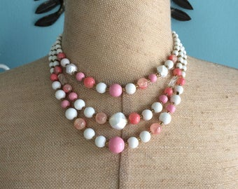 Japan triple strand pink and white beaded multistrand necklace
