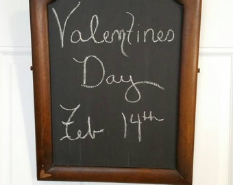 Antique walnut frame Reimagined into decorative chalk board or message board.