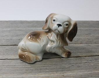A sweet little ceramic Pekingese figurine. A midcentury classic figurine made in Japan