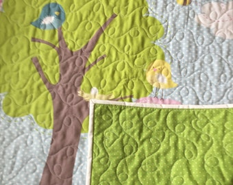 Beautiful quilt in elephant and turtle cotton fabric Machine quilted by me. An heirloom quality quilt for the baby/ toddler