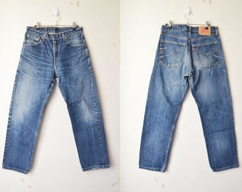 SALE // Levi's 521 dark blue washed high waist mom jeans // W33 L32