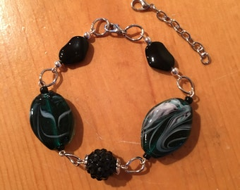 Bracelet. Large Green Glass Beads. Black Beads. Silver. Includes Extension.
