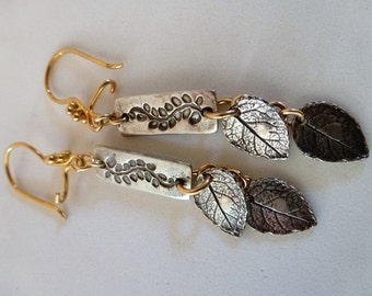 Silver Leaves Earrings sparkle with sterling silver carved leaf bars and leaves and gold beaded earwires and chain.