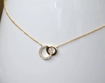 Gold handcuff necklace zirconium