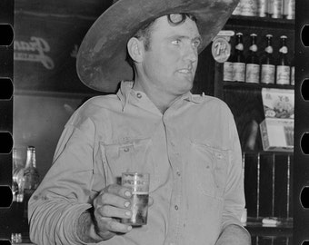 Cowboy enjoying a Beer in a Bar, Alpine, Texas, 1930's, Old Photo