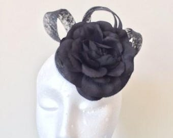 Gorgeous black flower fascinator with black sinamay loops. Stunning on!