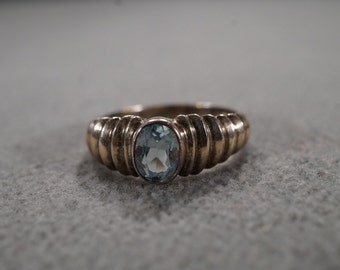 vintage sterling silver solitaire ring with large oval faceted blue topaz in a scalloped setting, size 9   M2