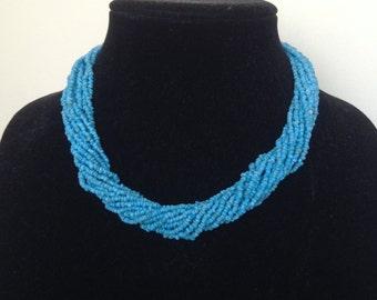 Necklace, Mostasilla Beads Necklace, 14 Strand with Light Blue Mostasilla Beads