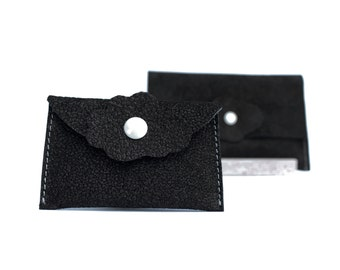 Black leather card holder; Available in varius kinds of black leather and in other colors