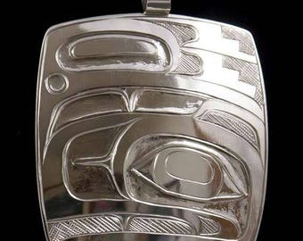 Northwest Native Old style Raven pendant of Sterling Silver , designed ,hand carved and engraved by Metis artist Terry Jackson