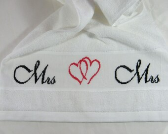 Hand-embroidered towel of Mrs. + Mrs in black or white