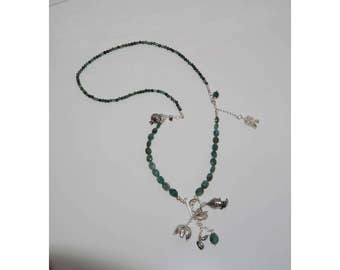 Emerald and sterling silver bird necklace.