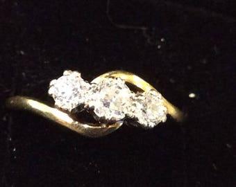 18ct gold diamond three stone ring ,cross over ,half carat