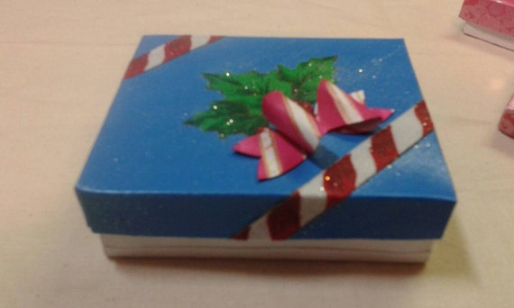 Christmas gift boxes decorated with fabric holly leaves and fabric candycane strips. Handpainted candy cane paper bows.U get 2 boxes. 3x2x4