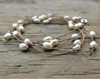 Freshwater pearl necklace. Freshwater pearls long necklace on a silk thread. June Birthstone