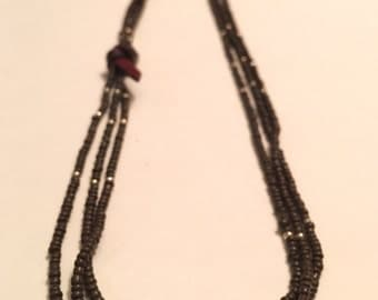 Long brown beaded necklace