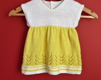 Hand knit baby dress in yellow and white