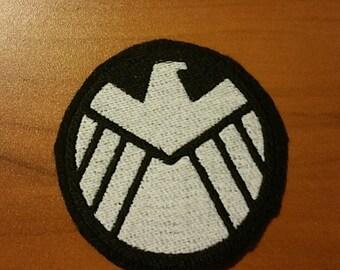 Marvel Comics Shield Symbol