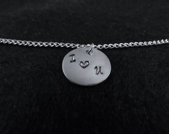 Hand stamped initials and heart on a chain