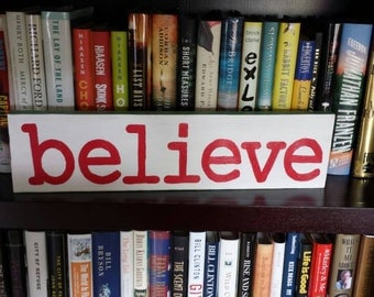 Handmade hand painted  wooden sign. Believe. Use for Christmas or keep out all year. Red lettering with green edges.