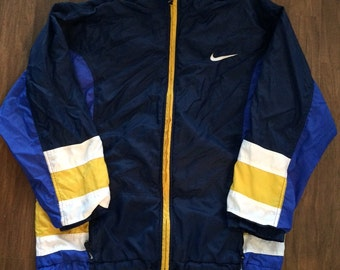 Vintage Nike zip down jacket with blowup back logo