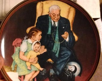 Knowles China , Bradbury mint Norman Rockwell Tender Loving Care collector plate 1988