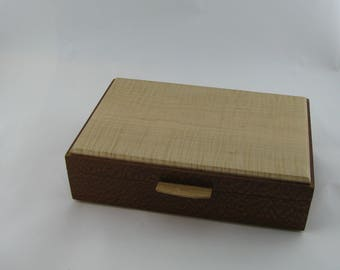 Tea box in Lacewood on the side 12 X 7 3/4 x 3 1/4.Top is made from figured Maple