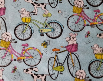 Dogs Riding Bikes Flannel Fabric Sold by the Yard