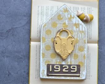 SALE: 1929 Metal Lock Yellow House Sign.