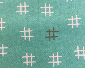 Hashtags on Turquoise from Basic Mixology Collection by Moda Fabrics