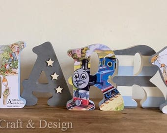 Character decorated letters. Choose any theme for your wooden letters....Thomas, Peter Rabbit, Disney Princess and many more.
