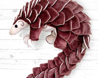 Plush toy designed to look like a pangolin