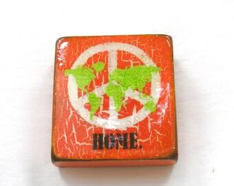"Bright Orange/Metallic Green World Map -HOME"" - World Peace/map of the world, orange love,h. gloss resin coat on solid, light spruce block."
