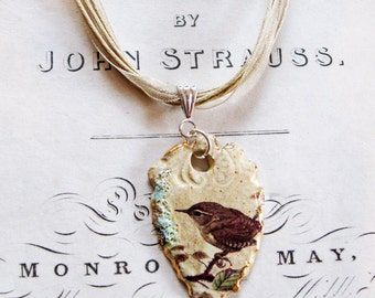 Hand made Ceramic Wren Pendant with an organza/cotton necklace, fired 5 times and highlighted with gold - a unique gift made in the UK
