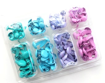 Box with 140 colorful brads (2 sizes, 4 different turquoise & purple tones)