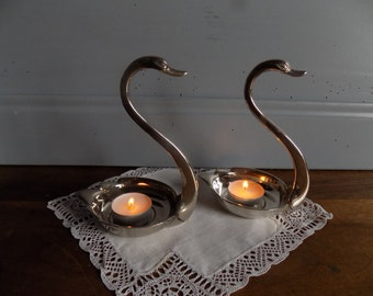 Beautiful pair of silver plated swan candle holders, tea light holders circa 1970s.