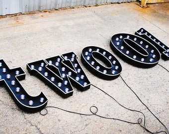 Metal letter marquee light Any Letter!! With weathered hand painted pinstripe and globe bulbs. Your choice of metal finish and accent color.